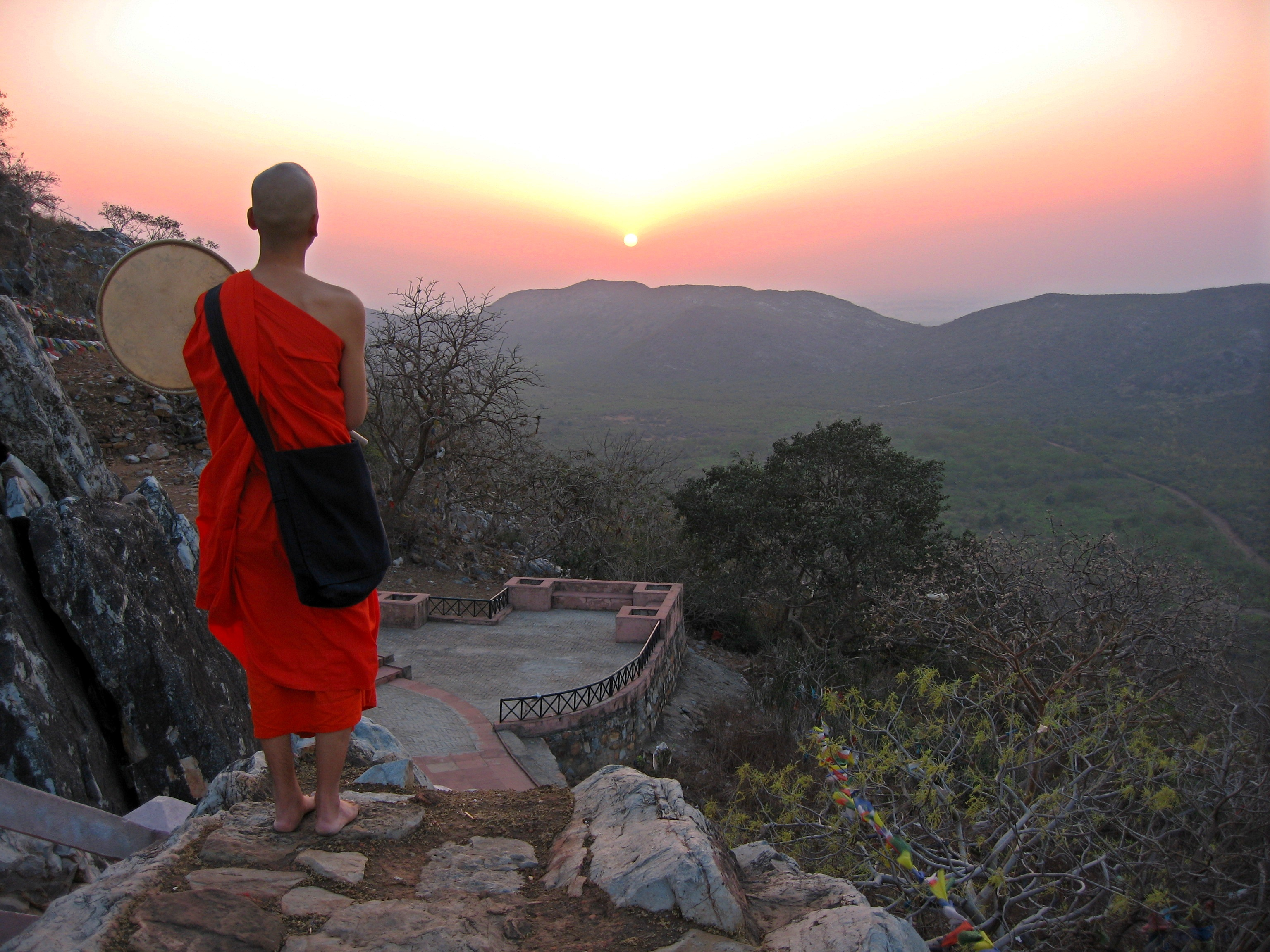 Young monk of the Nipponzan Myōhōji Order during his morning meditation practise on Gridhakuta (Vulture Peak) near Rajgir